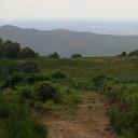 Photo prise depuis les Chaumes d'altitude, avec vue sur des collines puis, au travers d'une brume légère, la vallée de Turin
